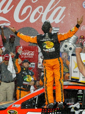 Martin Truex celebrates winning the Coca-Cola 600 at Charlotte Motor Speedway.