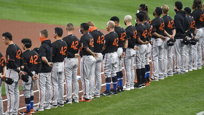 Baltimore Orioles players line up on their baseline before a baseball game against the Toronto Blue Jays in Buffalo, N.Y., Friday. All players and coaches wore #42 uniforms in honor of Jackie Robinson Day around the league.