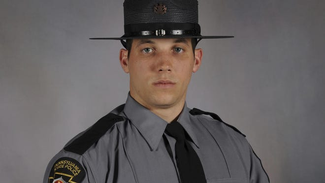 This undated photo provided by Pennsylvania State Police shows Trooper Michael P. Stewart. Stewart was killed and another trooper injured early Friday, July 14, 2017, when their patrol car collided with a garbage truck in Ligonier Township, Pa., southeast of Pittsburgh. (David J. Watson/Pennsylvania State Police via AP)