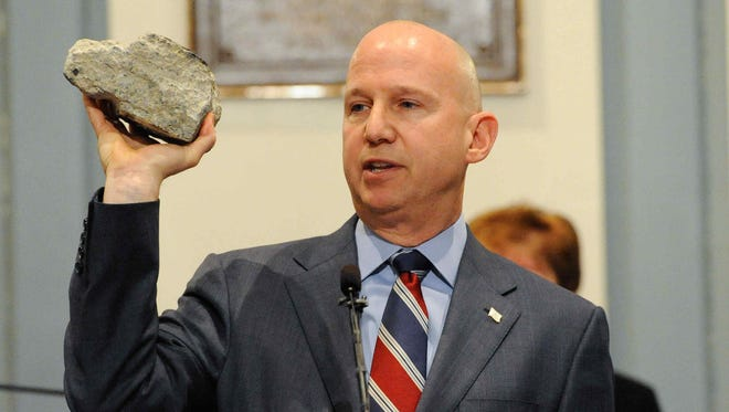 Holding up a chunk of concrete from the I-95 bridge, Gov. Jack Markell called on lawmakers Thursday to come forward with ideas to help close a $780 million gap between transportation infrastructure funding and what transportation officials say is needed.