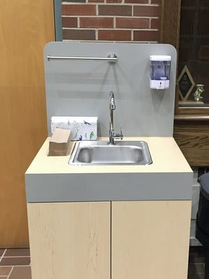 A portable washing station at the entrance of Clinton High School, outside the auditorium, is ready for students to return Sept. 16.