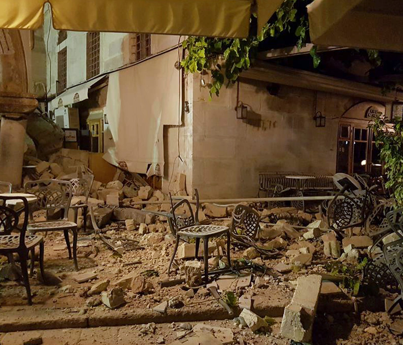 A cafe setting is littered with rubble following a strong earthquake on the Greek island of Kos early Friday, July 21, 2017.