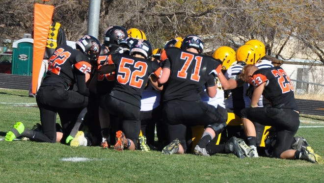 Capitan and Raton football players meet on the field to pray for injured Raton player Alec Valestad during the 2016 U.S. Bank State Football Championships 3A Quarterfinals Nov. 19 in Capitan.