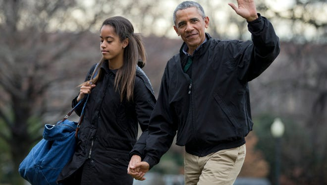 President Obama and daughter Malia return to the White House on Jan. 4, 2014.