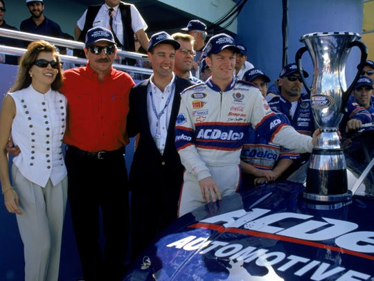 Dale Earnhardt Jr., right, celebrates with father Dale