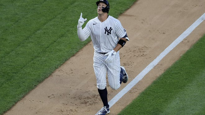 New York's Aaron Judge reacts as he approaches home plate after hitting a two-run home run during the third inning against the Sox at Yankee Stadium Friday night.