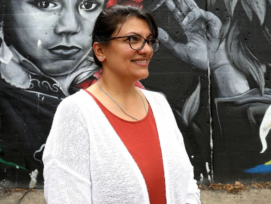 Rashida Tlaib in front of one of the murals in southwest Detroit on Aug. 21, 2018.