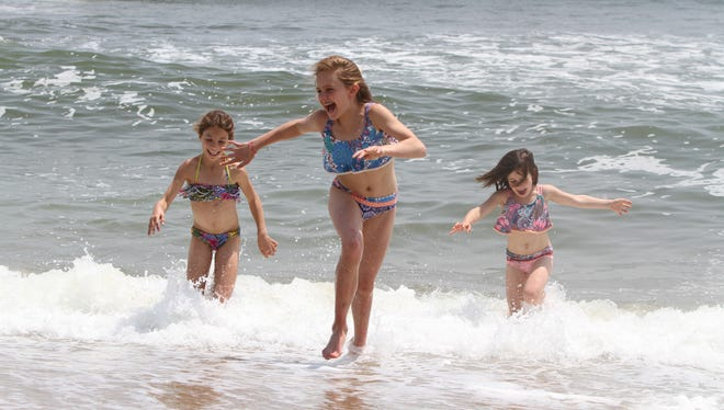 Ally Pellegrino, 9, Emily Thompson, 10, and Isabella Pellegrino, all of Basking Ridge, enjoy a day on the beach in Ocean Grove, NJ Wednesday May 25, 2016.