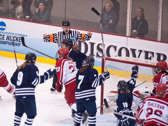 Middlebury College players react as the referee waives