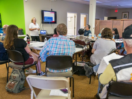 Sheila Mitchell, top left, conducts a training session for shelter volunteers at the Northwest Chapter of the American Red Cross in Pensacola on Thursday, September 7, 2017.