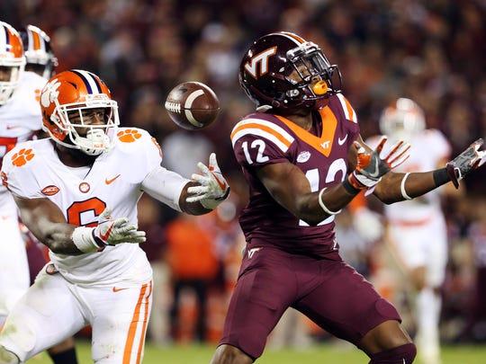 Clemson linebacker Dorian O'Daniel (6) intercepts a pass intended for Virginia Tech wide receiver Henri Murphy (12) during the fourth quarter at Lane Stadium.