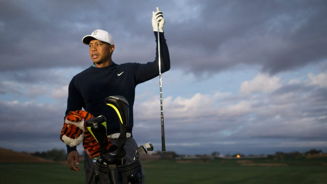 Tiger Woods works on the driving range before his practice round on Jan 27, 2015, at the Waste Management Phoenix Open at TPC Scottsdale.