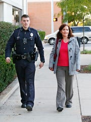 Nora Ashcraft walks with Officer Josh Brainard to his car Thursday, October 13, 2016, outside Lafayette Police Department headquarters at Sixth and South streets in downtown Lafayette. Ashcraft is a domestic violence advocate who rides along with LPD officers each Thursday evening. She said she rides along for four to five hours or longer if necessary.