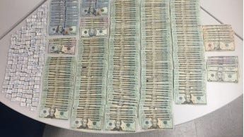 A state trooper pulled over a speeding vehicle along I-95 southbound and found more than 1,400 bags of heroin and suspected drug proceeds inside.