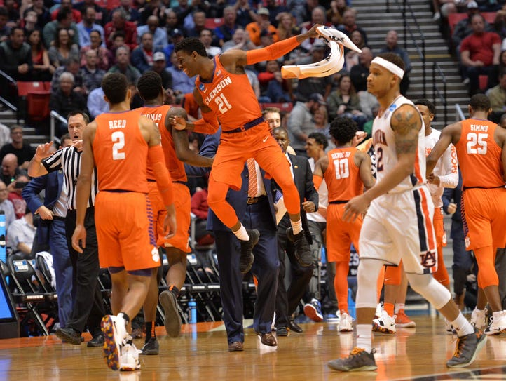 Clemson Tigers guard Anthony Oliver II (21) reacts