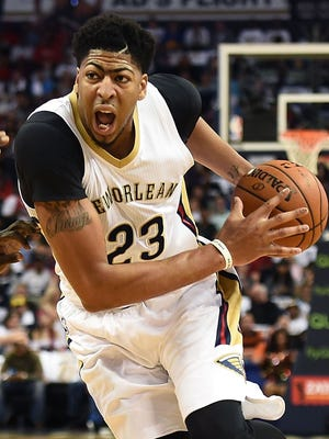 Anthony Davis no. 23 of the New Orleans Pelicans drives to the basket.
