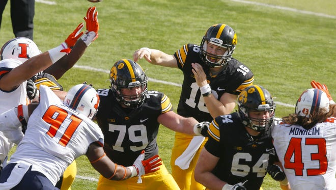 Iowa quarterback C.J. Beathard (16) is protected by left guard Sean Welsh (79) and Cole Croston (64) against Illinois on Oct. 10. Iowa moved James Daniels to right tackle on an emergency basis that game when Ike Boettger got hurt.