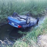 Passing motorists pull teen from flipped car in ditch