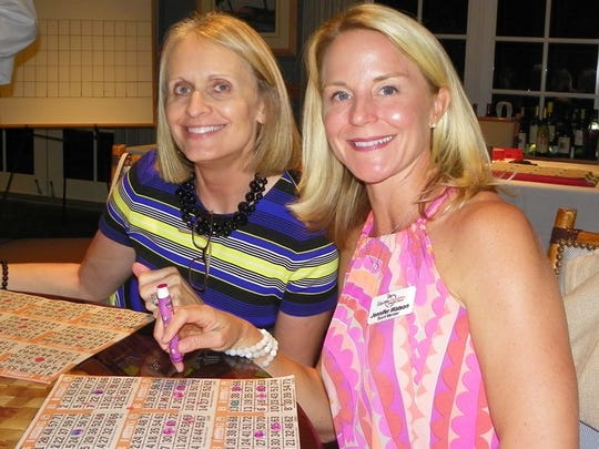Tracey Bockhorst and board member Jennifer Watson were playing bingo for designer handbags.