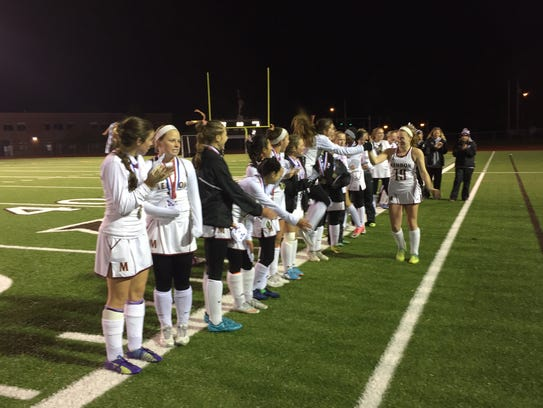 Top-seeded Pittsford Mendon defeated No. 2 Brighton, 2-0, to repeat as Class B/C sectional champions at East Rochester High School, Monday.