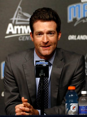 Orlando Magic general manager Rob Hennigan talks with media as Frank Vogel is introduced as the new head coach during a press conference at Amway Arena.