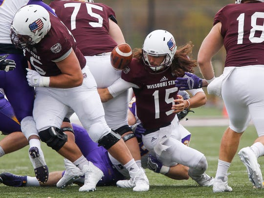 Bears quarterback Peyton Huslig recovers his own fumble during their 25-10 loss to Northern Iowa at Plaster Stadium on Saturday, Nov. 11, 2017.