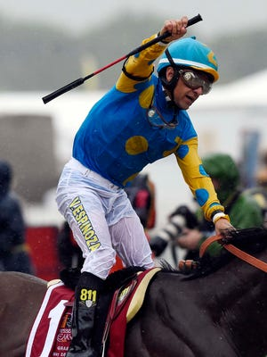 Victor Espinoza aboard American Pharoah celebrates winning the 140th Preakness Stakes at Pimlico Race Course.