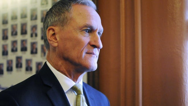 Dennis Daugaard FILE - In this Jan. 10, 2017, file photo, South Dakota Gov. Dennis Daugaard waits to give his State of the State address at the state Capitol in Pierre, S.D. Daugaard has vetoed a pair of gun bills coveted by conservative lawmakers, setting up likely veto override attempts when the Legislature returns to Pierre in March. (AP Photo/James Nord, File)