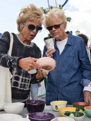 Sharon Werner and Lyn Burleson select a bowl at the 11th Annual Empty Bowls event benefiting Treasure Coast Food Bank.