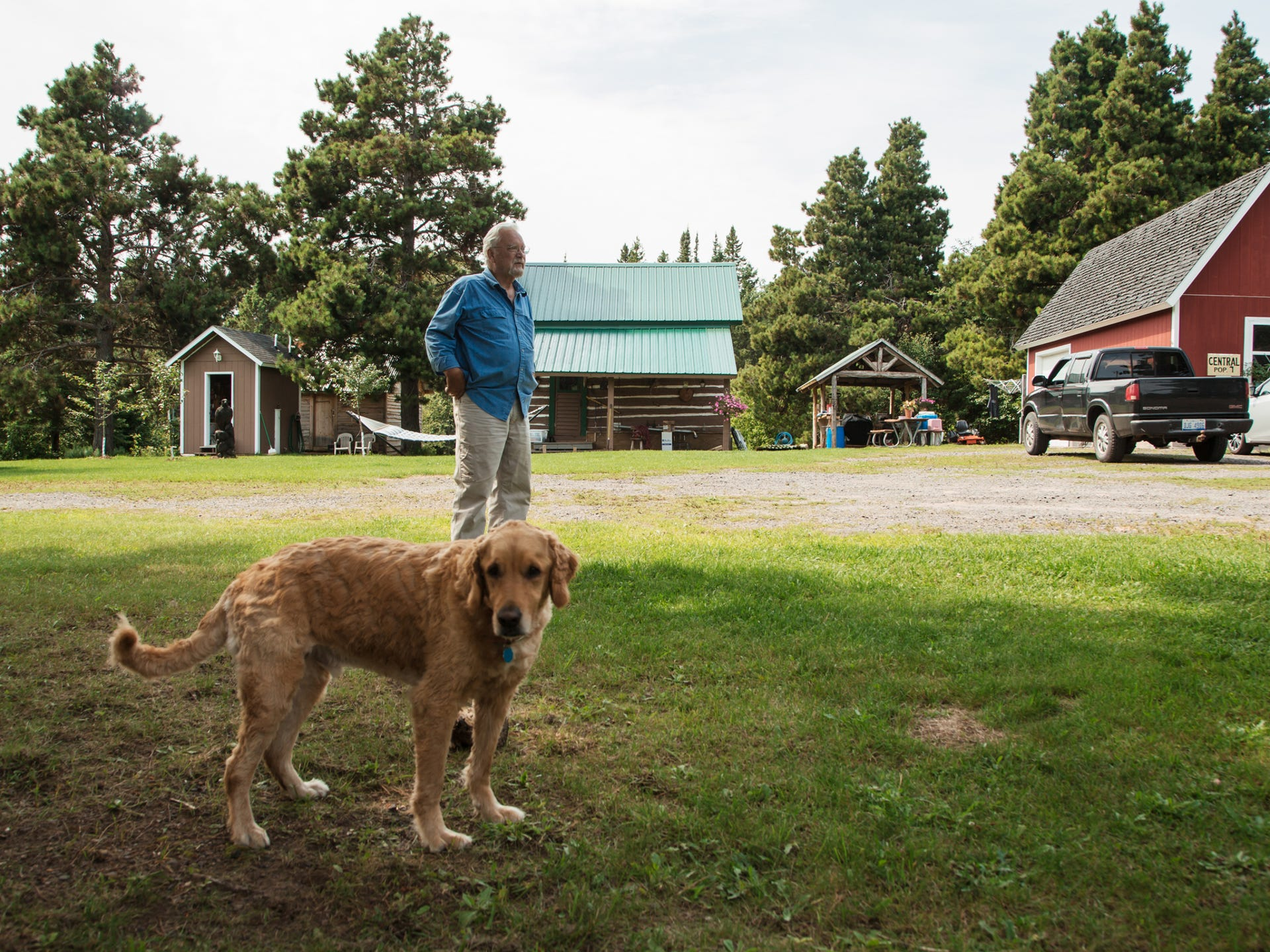 Jim Vivian, 74, stands with his dog in front of the
