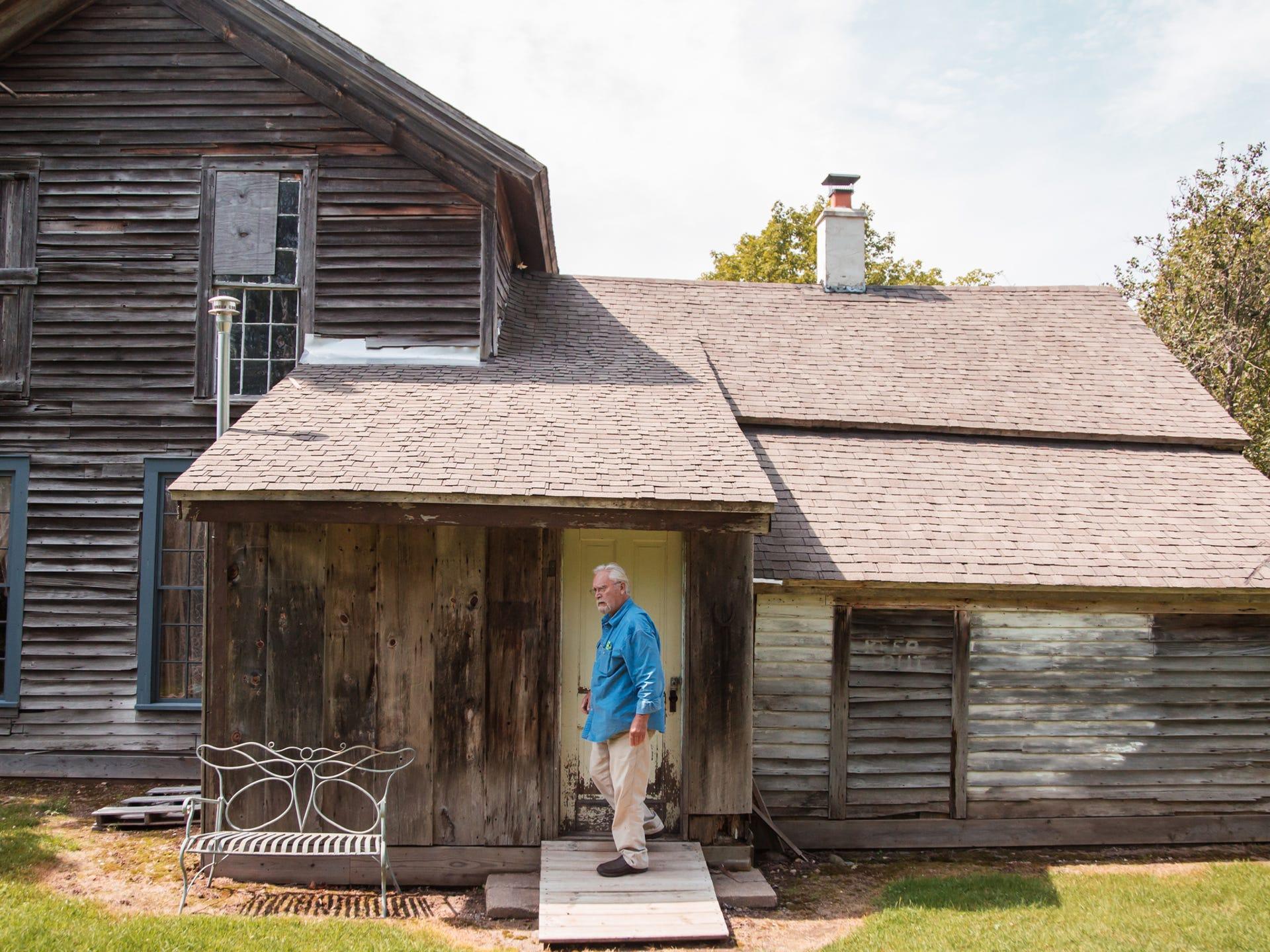 Jim Vivian, 74, steps out of a refurbished miner's