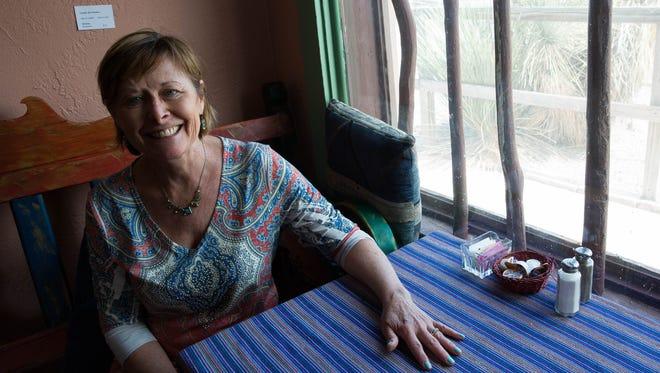 Café de Mesilla owner Joyce Zimmer sits at a table in Café de Mesilla, Friday, April 14, 2017.