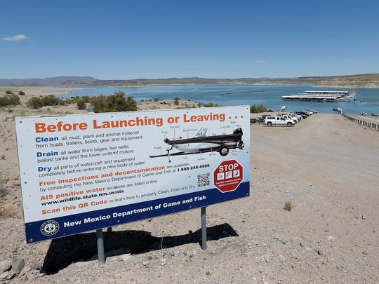 A sign atop the boat launch ramp at Elephant Butte informs boaters how to reduce the risk of transering invasive species between lakes in New Mexico.