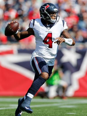 Texans quarterback Deshaun Watson rolls out to pass during the first half against the Patriots on Sept. 24, 2017, at Gillette Stadium.