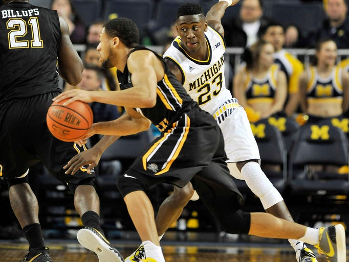 Michigan's Caris LeVert, right, defends Northern Kentucky's