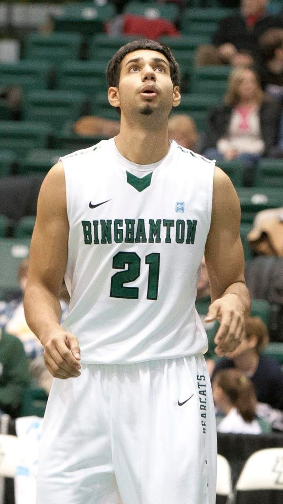 Binghamton University forward Nick Madray plays during