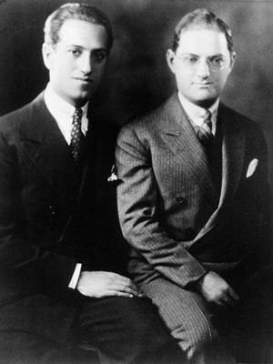 Composer George Gershwin, left, and his older brother and lyricist Ira Gershwin