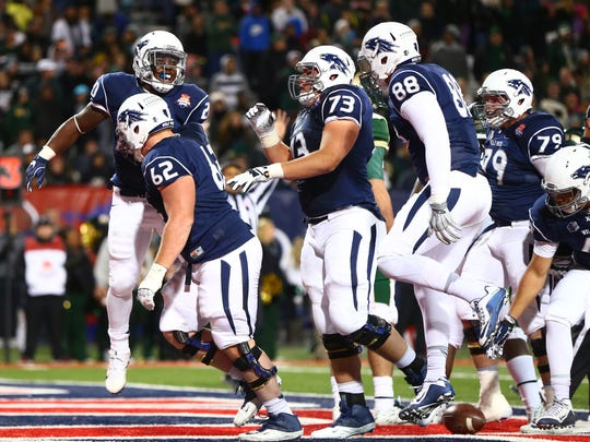 Nevada players celebrate during their 2015 Arizona Bowl win over Colorado State.