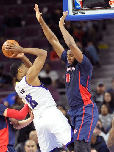 Pistons' Andre Drummond blocks the path of the Kings'