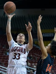 New Mexico State's Jeneva Toilolo puts up the short