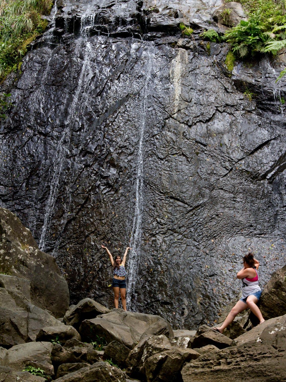 Visitors at La Coca Falls in El Yunque National Forest,