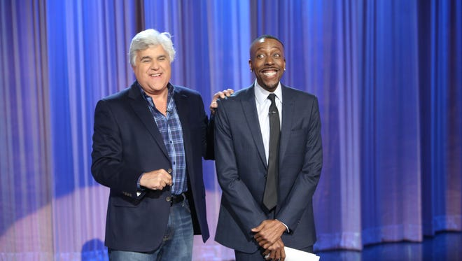 Arsenio Hall is all smiles after Jay Leno's show renewal news.