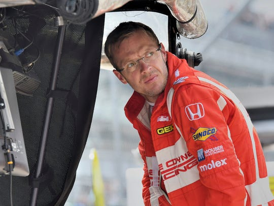 Sébastien Bourdais finds shelter under the pit box canopy after setting quick time in early practice at the Indianapolis Motor Speedway on May 19, 2017.