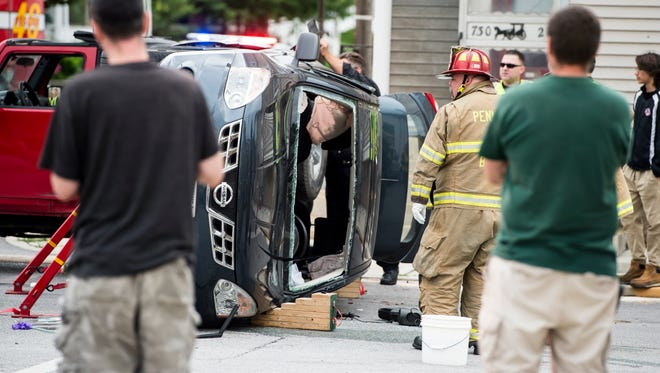 Emergency personnel work the scene of a multi-vehicle crash Tuesday afternoon in Penn Township.