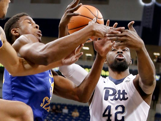 Pittsburgh's Peace Ilegomah (42) and McNeese State's Stephen Ugochukwu battle for a rebound in the first half of an NCAA college basketball game, Saturday, Dec. 16, 2017, in Pittsburgh. (AP Photo/Keith Srakocic)