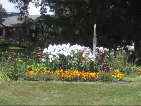 A bright and cheery circle of flowers greets visitors to 11500 W. Edgerton Ave.  It was one of the winners of the 2017 Hales Corners Community Pride awards.
