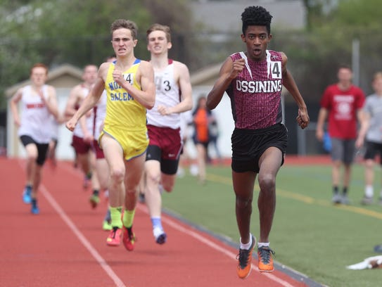 Ossining's Patrick Saint Ange wins the boy's mile during