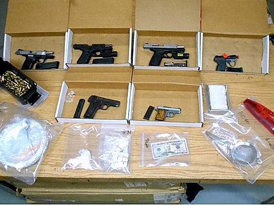 Police seized a large quantity of several drugs and seven handguns Monday morning at an Elmira residence.