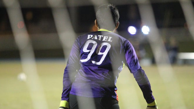 Left: Godby senior goalie Neel Patel watches as Wakulla moves the ball his way during Wednesday night's home game.