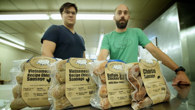 Will Branch (left) of Ferndale and Zachary Klein of Howell are the owners of Corridor Sausage Co. in Eastern Market.